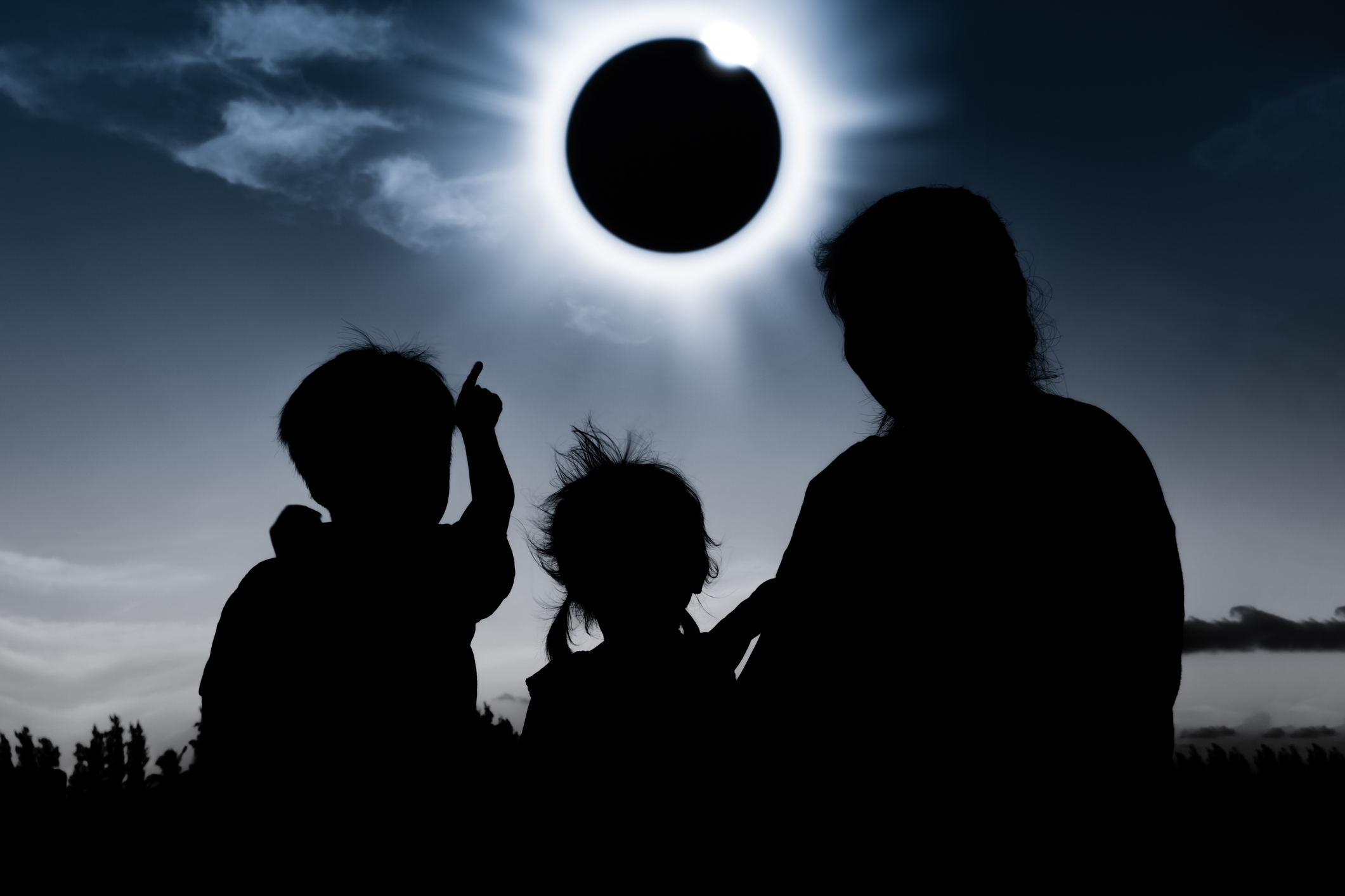 Natural phenomenon. Silhouette of family sitting and relaxing together.